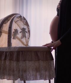 pregnant mom with bassinet